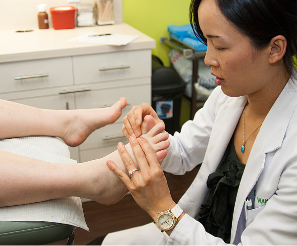 Dr. Alice Wang evaluates a patient with hallux limitus.